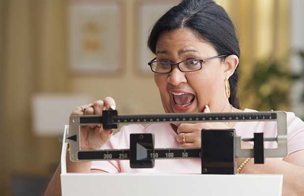 Overweight woman on weight scale